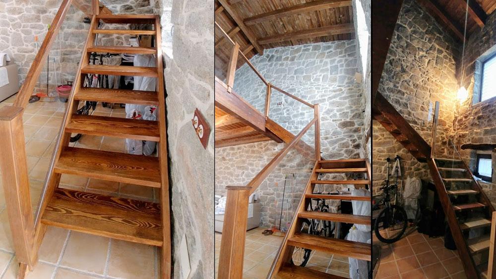 Escalera de madera y cristal en casa rústica de piedra